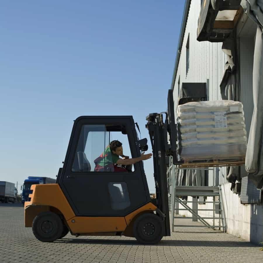 Worker using forklift